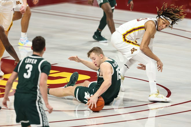Minnesota Joffers striker Brandon Johnson (23) and Michigan State Spartans striker Thomas Keither (15) fight for the ball during the first half December 28, 2020 at the Williams Arena.
