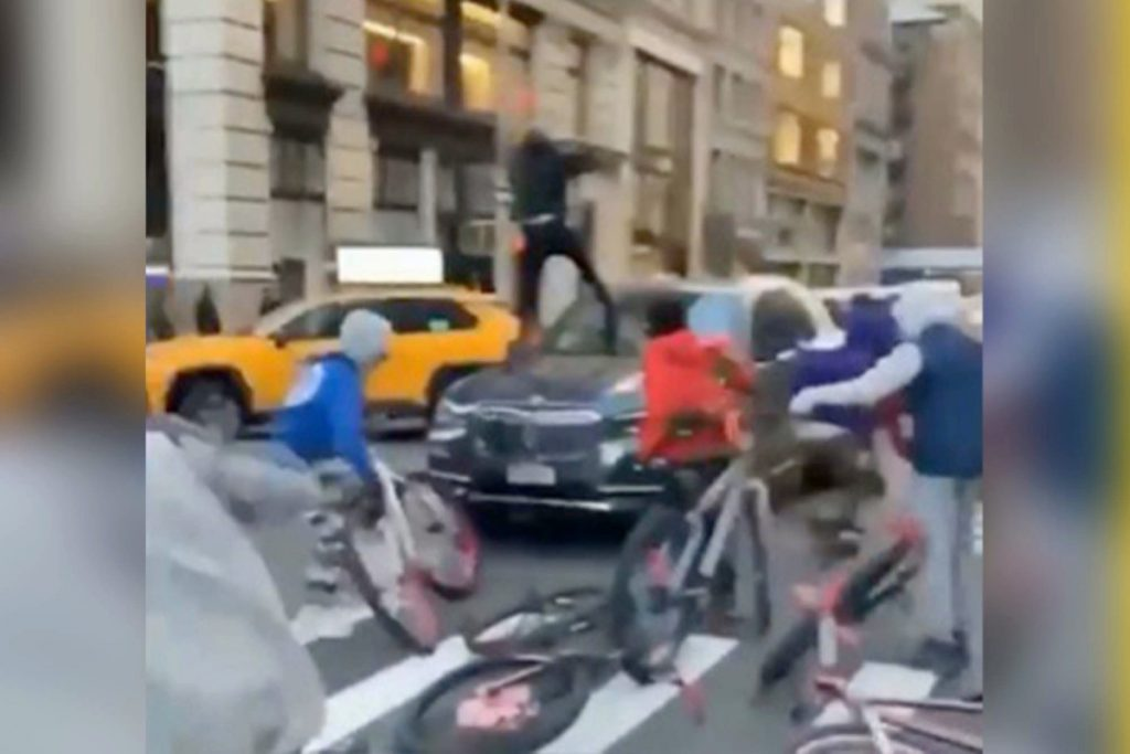 A 15-year-old has been arrested for the BMW bike gang attack in New York City