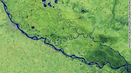 On July 3, 2020, Landsat 8 operational ground imager captured this false-color image of the river near Rosario, a major port city in Argentina.
