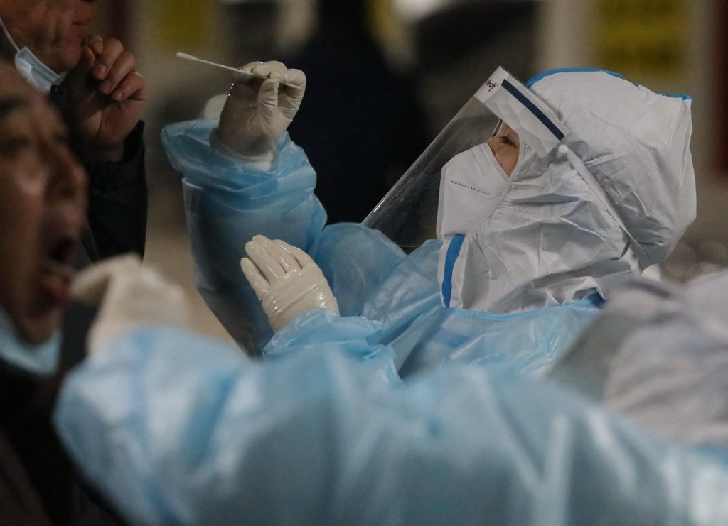 China reported its first Covid death in more than six months with the arrival of WHO investigators