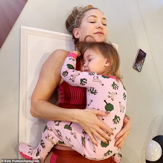 Busy mom: Kate Hudson on Sunday opened up about her experience as a mother, specifically regarding the fact that her three children have a different father.