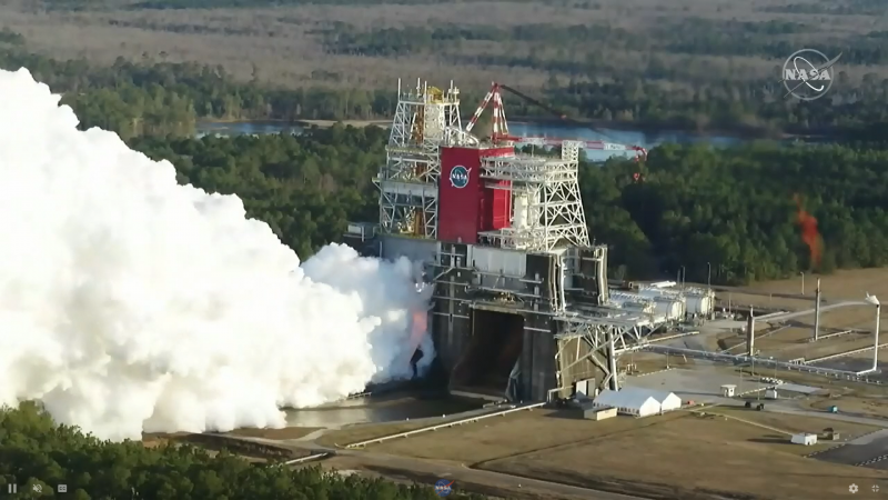 A huge cloud of smoke or steam poured out from the multi-story test platform.